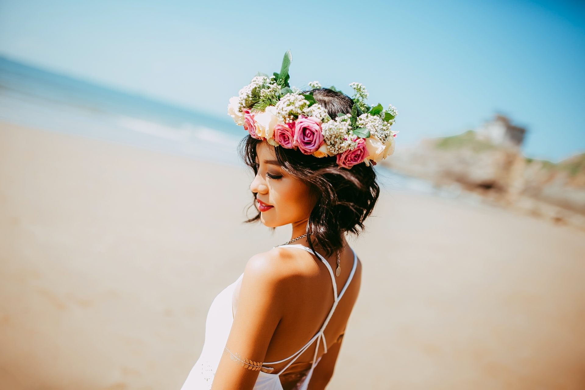 asian philippine girl with flowers in hair